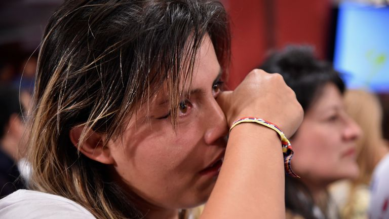A woman cries over the results of a referendum on whether to ratify a peace accord with FARC rebels, in Bogota. Colombians narrowly voted to reject the deal
