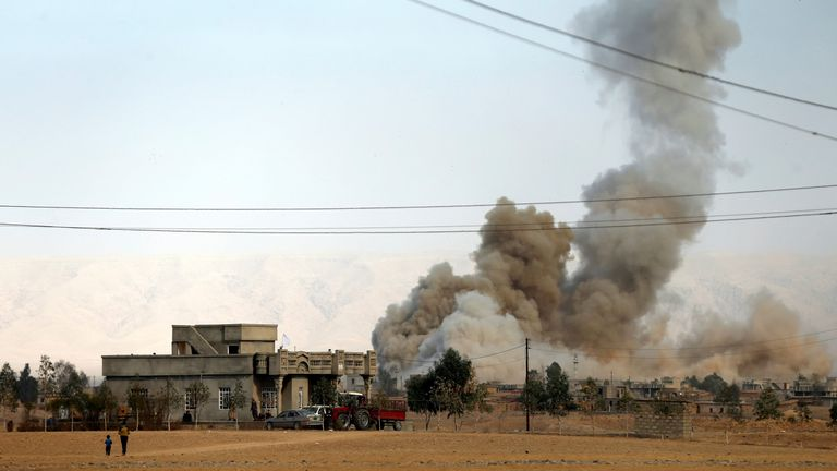 Smoke rises from a bomb attack south of Mosul, during an operation to attack Islamic State militants