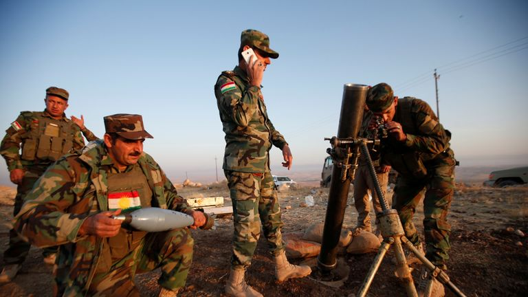 Peshmerga forces prepare to launch a mortar against Islamic State militants in the town of Naweran near Mosul
