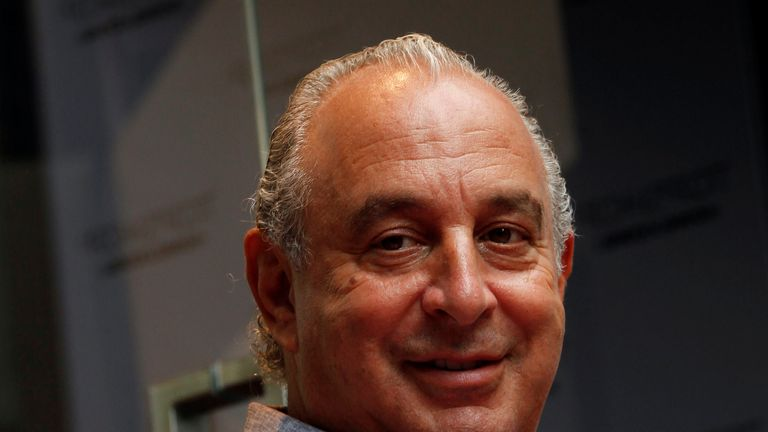 British billionaire and CEO of the Arcadia Group Philip Green smiles as he attends the opening ceremony of a Topshop flagship store in Hong Kong June 6, 2013. REUTERS/Bobby Yip/File Photo