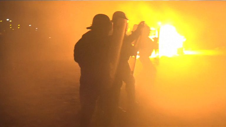 French riot police clash with migrants at Calais 'jungle'