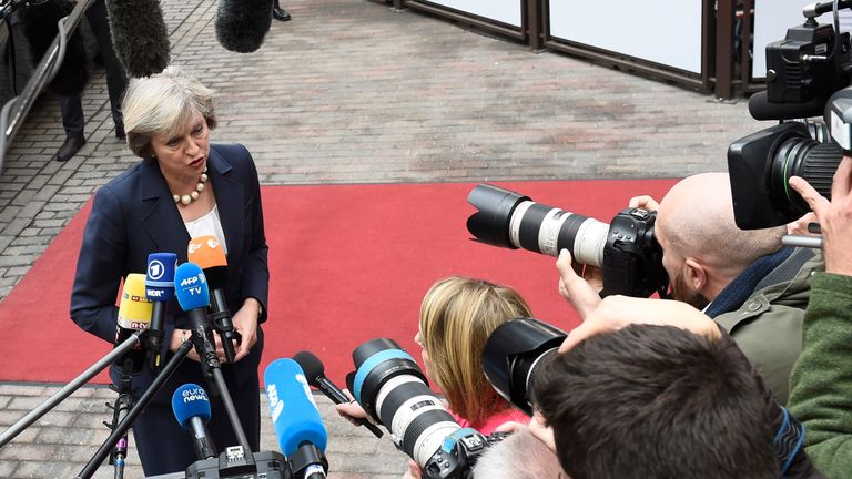 Prime Minister Theresa May is interviewed by reporters.