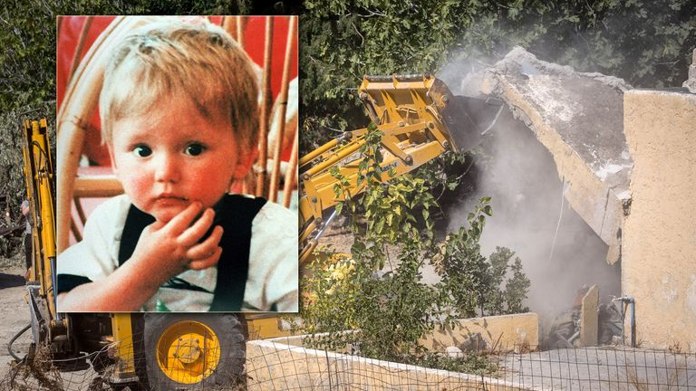 A bulldozer demolishes the last room of the farmhouse at the search site of missing toddler Ben Needham
