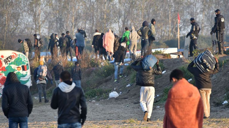 Hundreds of migrants remain in and around the camp