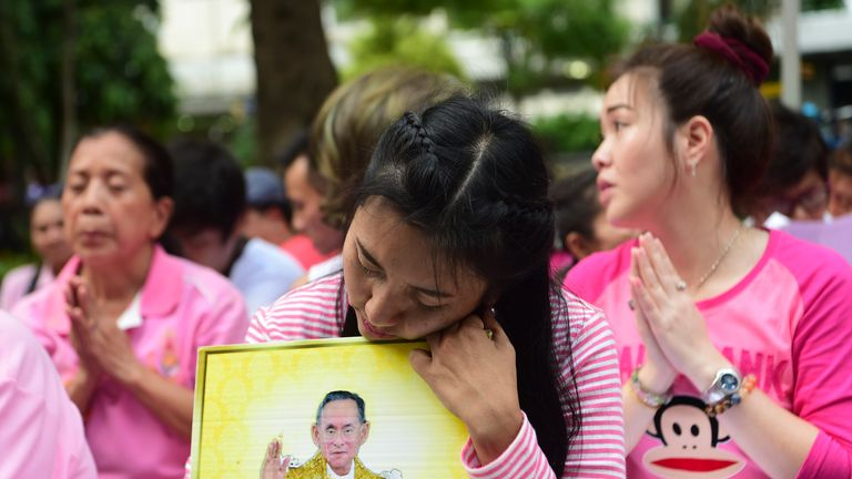 People mourn the death of Thailand's king in Bangkok