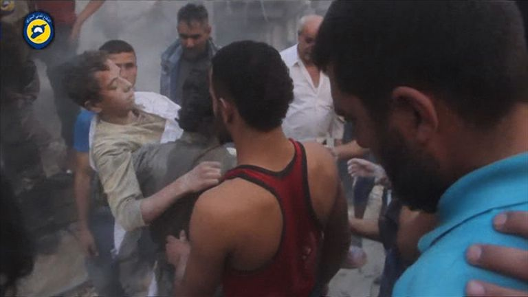 A boy is pulled from rubble following an airstrike on Aleppo