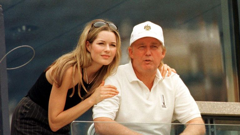 Donald Trump and his then-girlfriend Celina Midelfart at the US Open in 1998