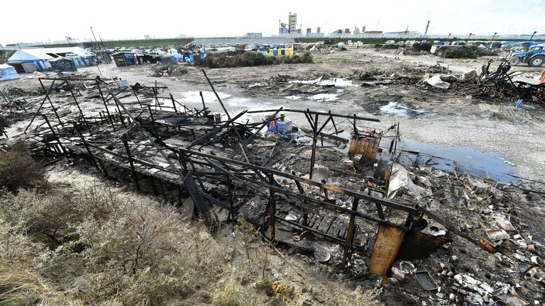 The charred remains of a building caught in one of the fires