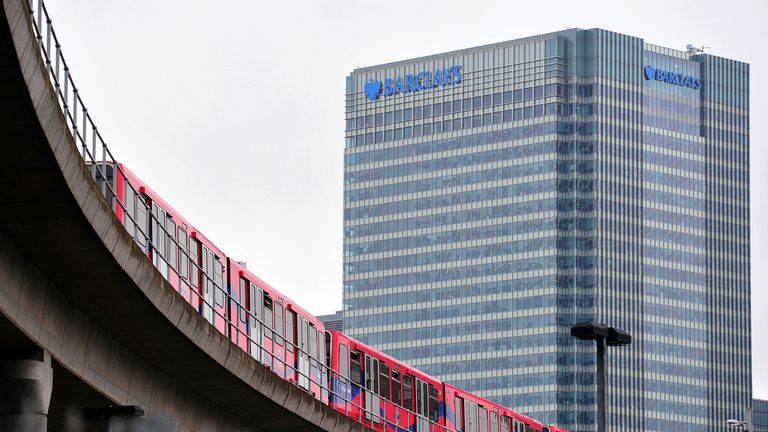 A DLR travelling through the City of London