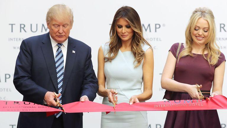 Republican presidential nominee Donald Trump, wife Melania and daughter Tiffany Trump cut the ribbon at the new Trump International Hotel