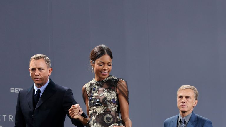 Actors Daniel Craig, Naomie Harris and Christoph Waltz attend the German premiere of Spectre