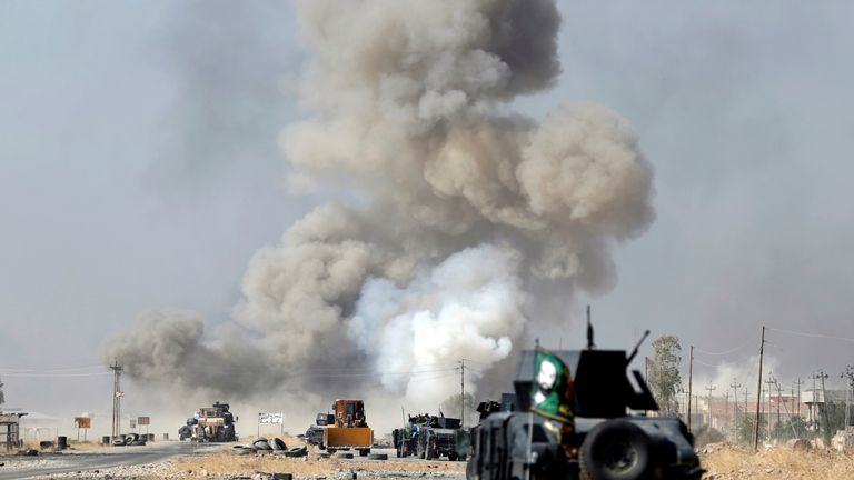 A roadside bomb explodes as Iraqi troops move on Mosul