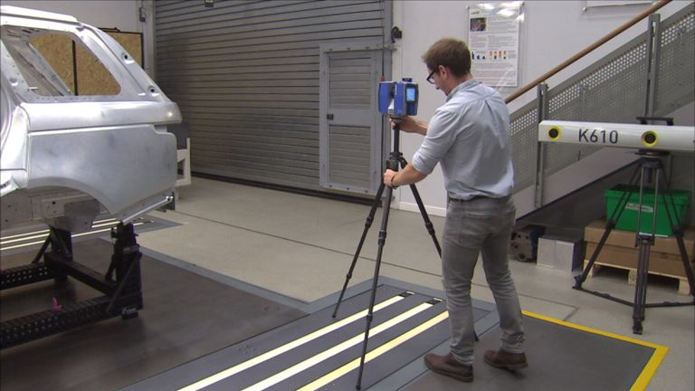 A camera begins the process of scanning a crime scene