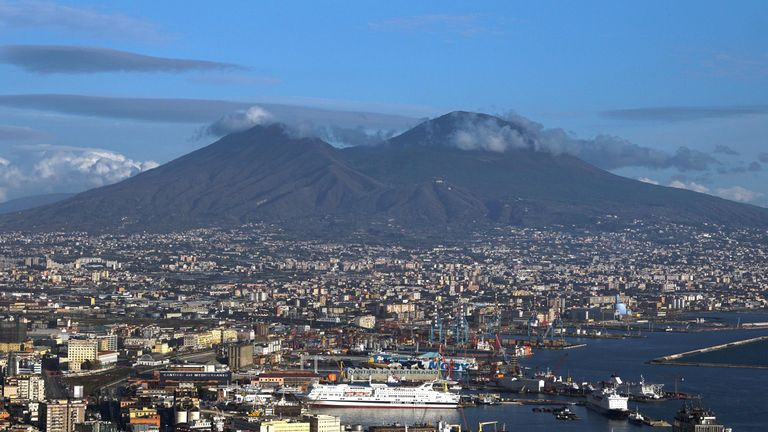 The city of Naples sits in the shadow of Mount Vesuvius
