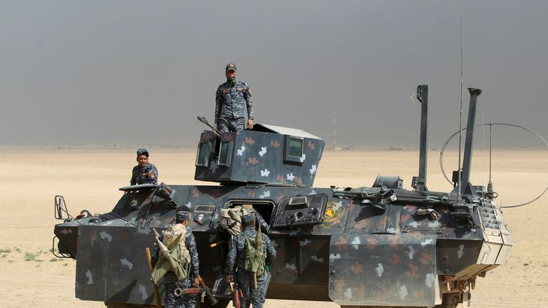Iraqi forces hold a position in the area of al-Shurah, some 45 kms south of Mosul, as they advance towards the city to retake it from IS jihadists