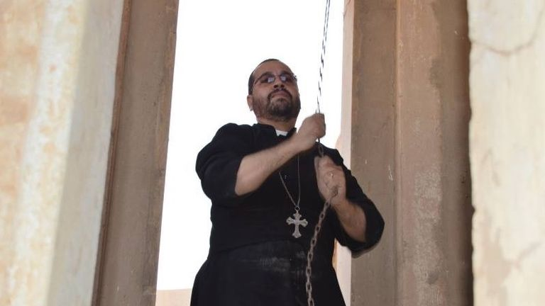 A man rings the bells of a Christian church in Bartella, near Mosul, which has been retaken from Islamic State. Pic: A Demand For Action