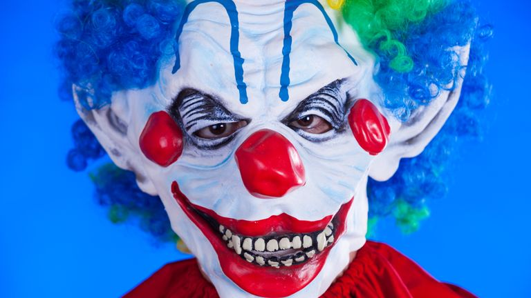 A file picture of a person in a scary clown mask