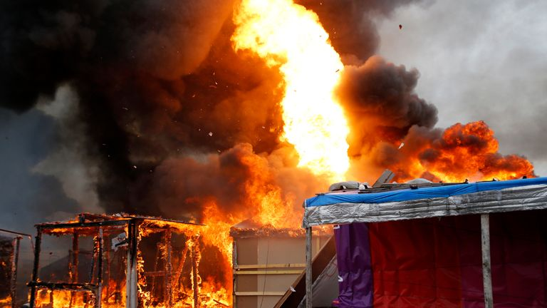 Fires rage in Calais as the 'Jungle' is dismantled