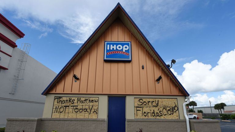 An IHOP restaurant closes up ahead of the storm