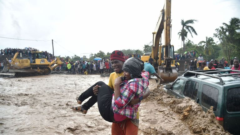 A person is carried across the river La Digue in Petit Goave where the bridge collapsed during the rains of the Hurricane Matthew,