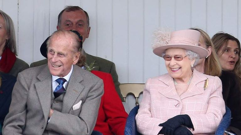 The Royal couple laugh as they watch the sack race during the annual Braemer Highland Games on 7 September 2013 in Braemar, Scotland