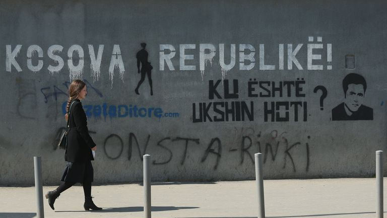 PRISTINA, KOSOVO - MARCH 20: Graffiti reads 'The Kosovo Rebublic!' and 'Where is Ukshin Hoti?' (Ukshin Hoti was a Kosovo Albanian activist imprisoned by Yugoslav authorities and who disappeared following his release from prison in 1999) on a wall at the Kosovo Assembly on March 20, 2016 in Pristina, Kosovo. Kosovo, following the Kosovo War of 1999 and its new-found independence, is still burdened with ethnic rifts and a weak economy. (Photo by Sean Gallup/Getty Images)