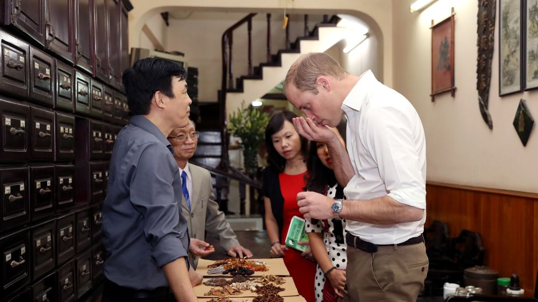 Prince William visits a traditional medicine shop in Hanoi