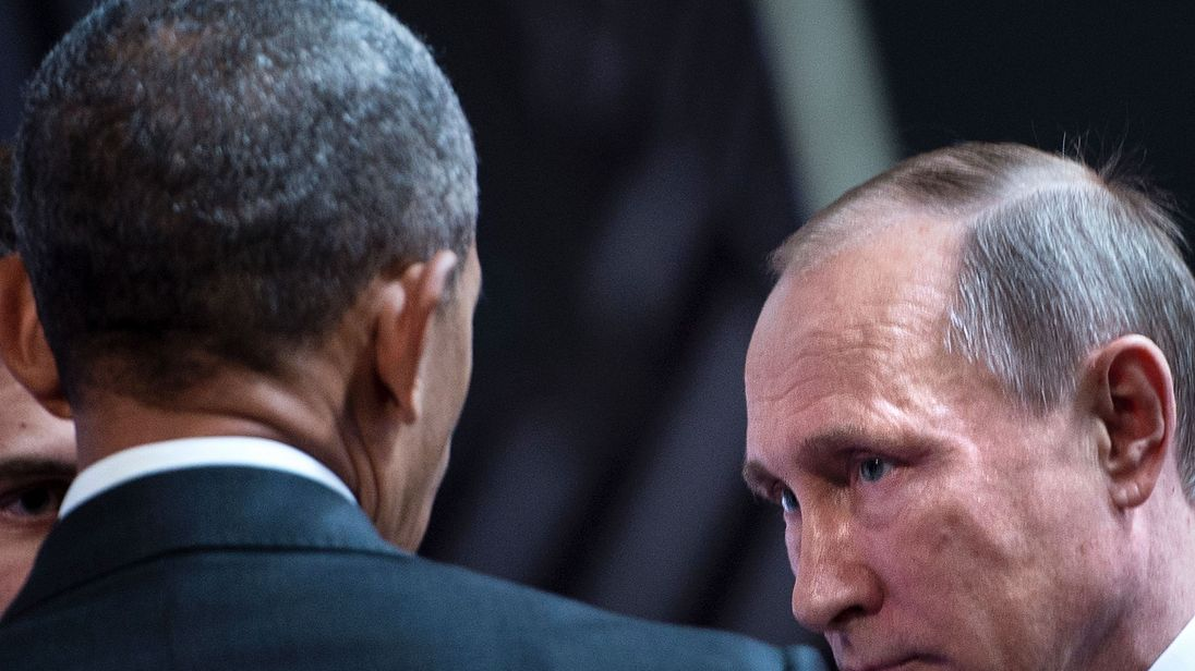 US President Barack Obama (L) and Russia's President Vladimir Putin (2nd-R) shake hands before an economic leaders meeting at the Asia-Pacific Economic Cooperation Summit at the Lima Convention Centre on November 20, 2016 in Lima. Asia-Pacific leaders are expected to send a strong message in defense of free trade as they wrap up a summit that has been overshadowed by US President-elect Donald Trump's protectionism
