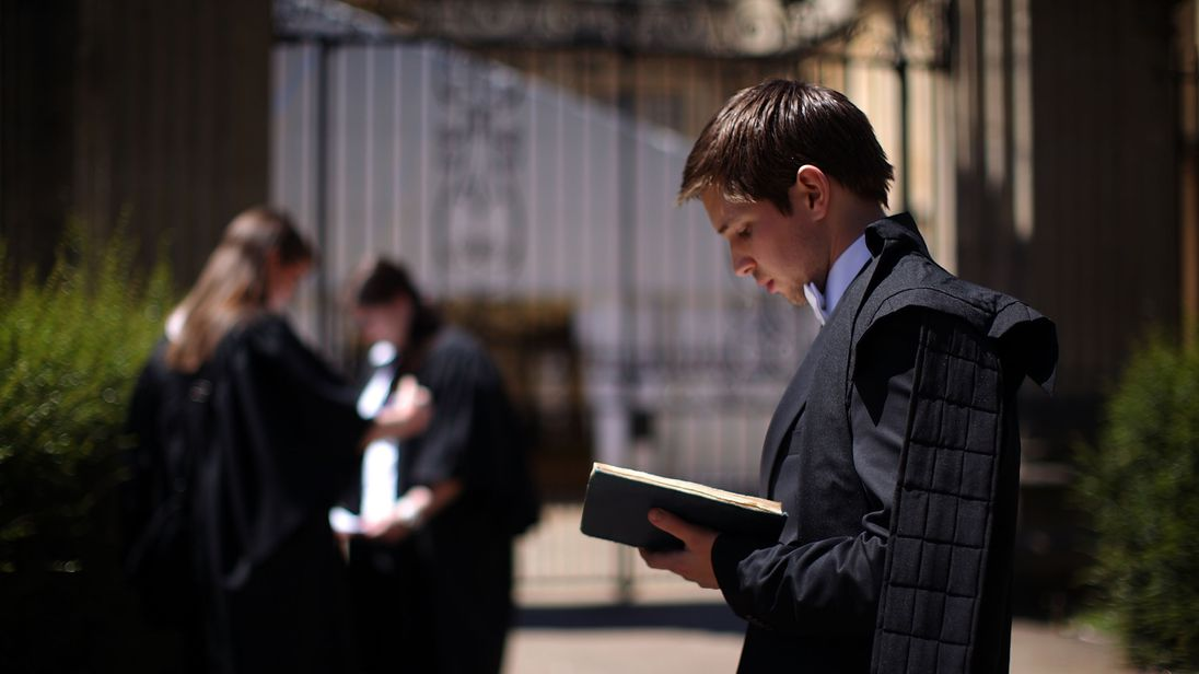 OXFORD, ENGLAND - JUNE 17: Oxford University students take in some last minute revision before entering the Exam Schools building to take examinations on June 17, 2010 in Oxford, England.