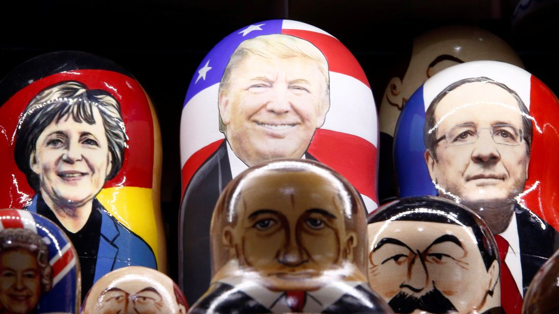 Painted Matryoshka dolls of German Chancellor Angela Merkel, Donald Trump and French President Francois Hollande