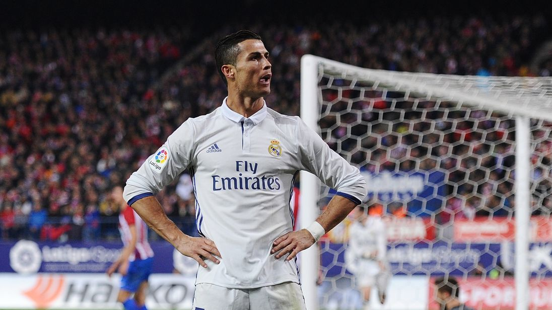 Cristiano Ronaldo of Real Madrid celebrates after scoring Real's 3rd goal during the La Liga match at Atletico Madrid