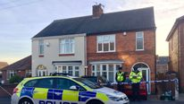 Police outside a house in Welwyn Road, Hinckley, Leicestershire, where the bodies of a man and two children were found in the early hours of November 2 2016
