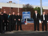 Members of the prison service gather outside HMP Liverpool on November 15, 2016 after prison officers stopped work in protest over conditions.
