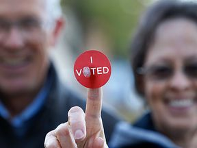 A couple shows off their 'I Voted' sticker after casting their ballot in Utah