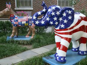 The symbols of the Democratic Party, a donkey, and Republican Party, an elephant