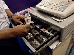 A cash register containing various pound notes and change