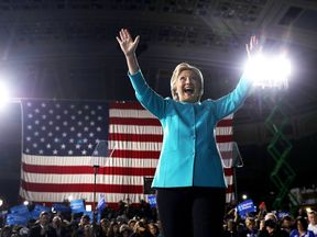 Hillary Clinton greets supporters during a campaign rally