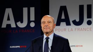 Mayor of Bordeaux and candidate for the centre-right primaries ahead of France's 2017 presidential elections, Alain Juppe, delivers a speech following the first results of the primary's second round on November 27, 2016, at his campaign headquarters in Paris