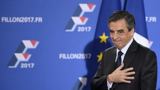French member of Parliament and candidate for the right-wing primaries ahead of France's 2017 presidential elections, Francois Fillon gestures as he delivers a speech following the first results of the primary's second round on November 27, 2016, at his campaign headquarters in Paris. France's conservatives held final run-off round of a primary battle on November 27 to determine who will be the right wing nominee for next year's presidential election