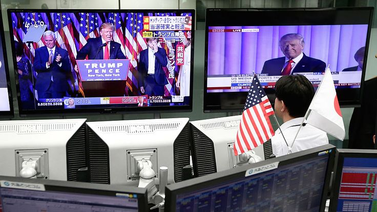 Traders watch Donald Trump's victory speech