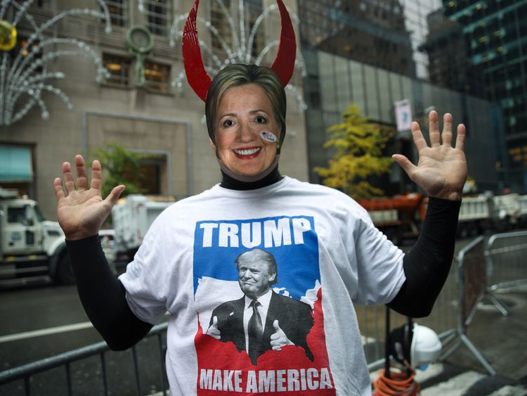 NEW YORK, NY - NOVEMBER 9: A supporter of Donald Trump wears a Hillary Clinton mask outside of Trump Tower, November 9, 2016 in New York City. Republican candidate Donald Trump won the 2016 presidential election in the early hours of the morning in a widely unforeseen upset. (Photo by Drew Angerer/Getty Images)