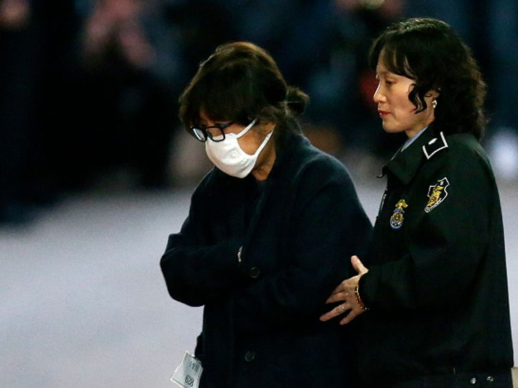 Choi Soon-Sil being escorted following her formal arrest