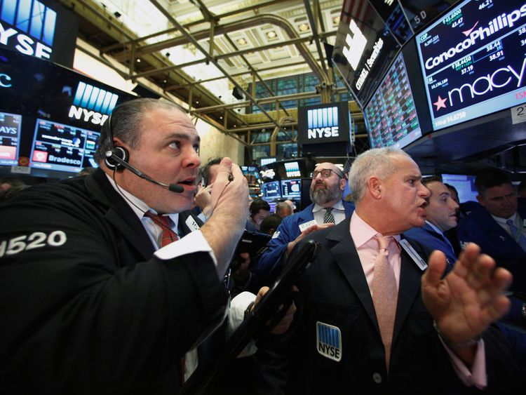 Traders on the floor of the New York stock exchange after Donald Trump's US election victory 9 November 2016