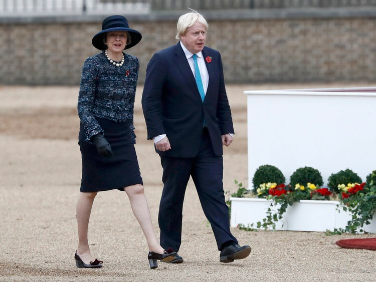 Theresa May and Boris Johnson arrive at the ceremonial welcome for Mr Santos