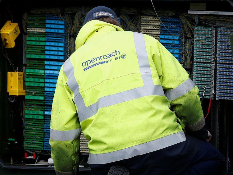 A BT Openreach engineer working on a telecoms cabinet near Manchester
