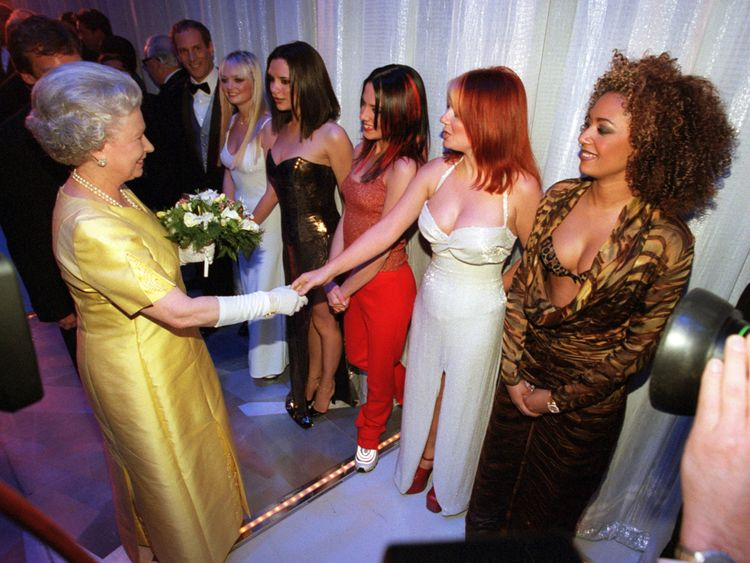 The Queen shakes hands with Geri Halliwell of Spice Girls in 1997