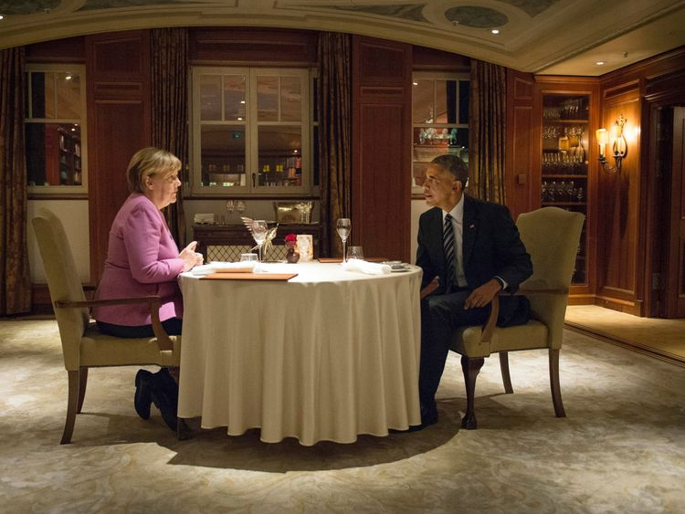 German Chancellor Angela Merkel and US President Barack Obama have dinner at the Hotel Adlon in Berlin