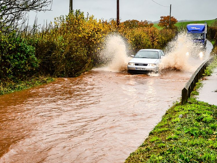 Cars creep through flood water on the main A396 between Tiverton and Exeter near, Upexe, as it runs off fields and collects on the main carriageway, as Storm Angus continues to sweep across the UK. Picture date: Monday November 21, 2016