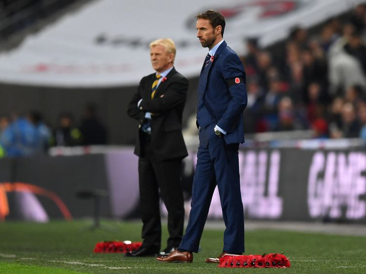 LONDON, ENGLAND - NOVEMBER 11: Gareth Southgate interim manager of England wears a Poppy black armband as he looks on alongside Gordon Strachan of Scotland during the FIFA 2018 World Cup qualifying match between England and Scotland at Wembley Stadium on November 11, 2016 in London, England. (Photo by Shaun Botterill/Getty Images)
