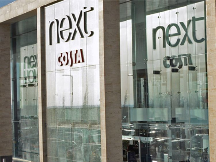 Next shares soar after surprise sales rise